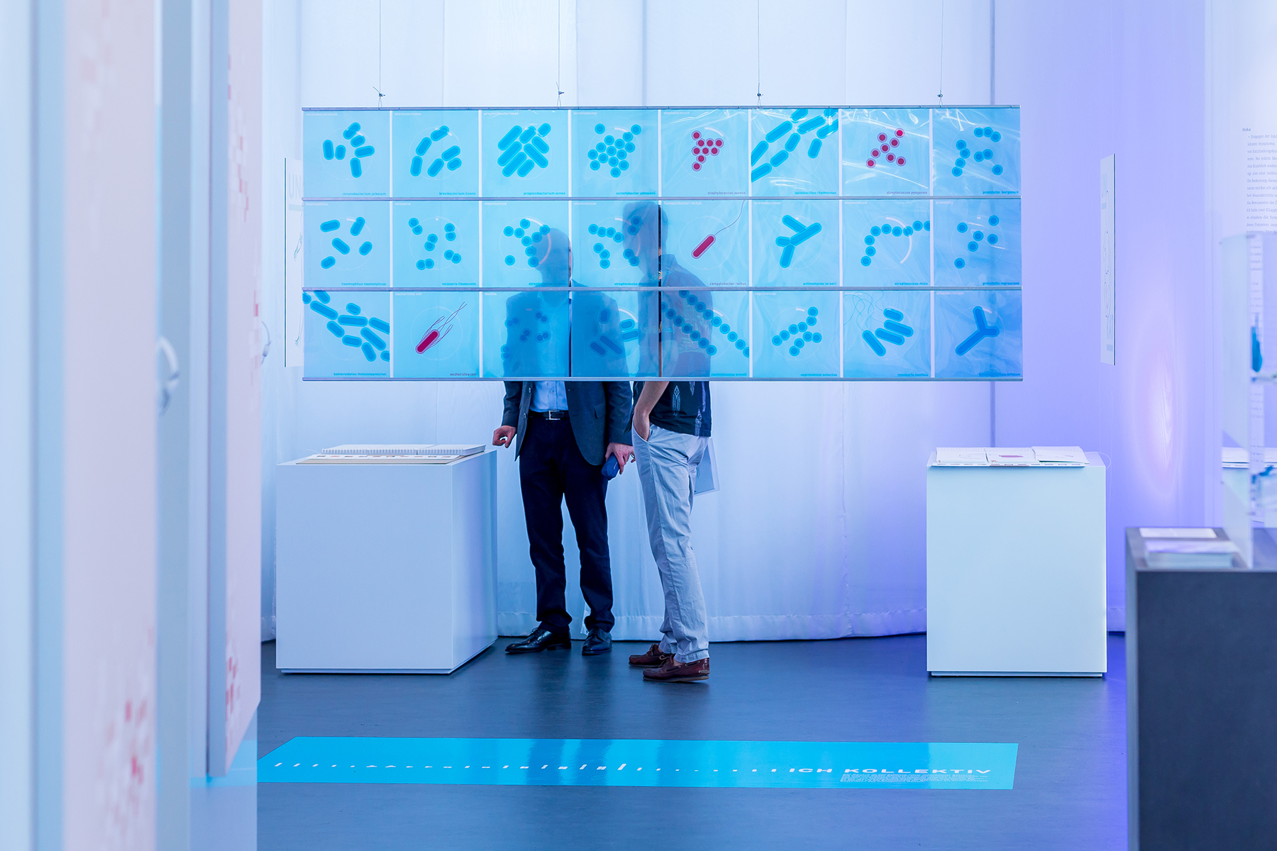 Two persons looking at an exhibition piece.